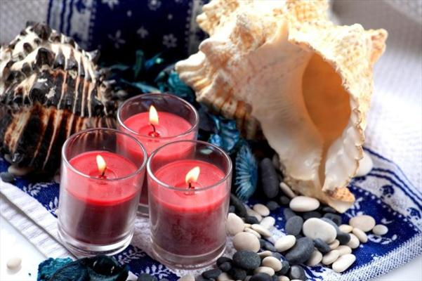beach themed party centerpiece candles pebbles crab sea shells