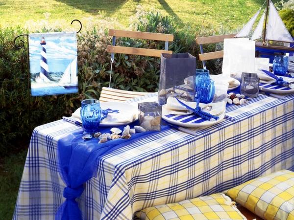 Beach themed party garden table setting nautical blue