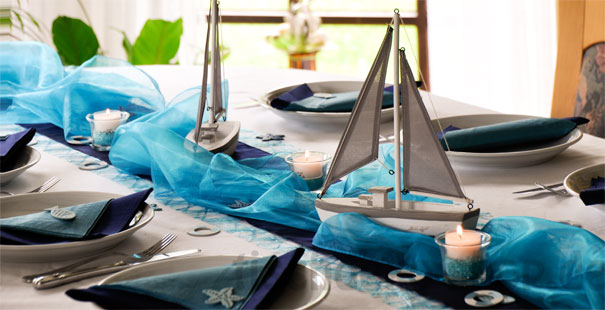beach themed party organza waves candles sailing boats