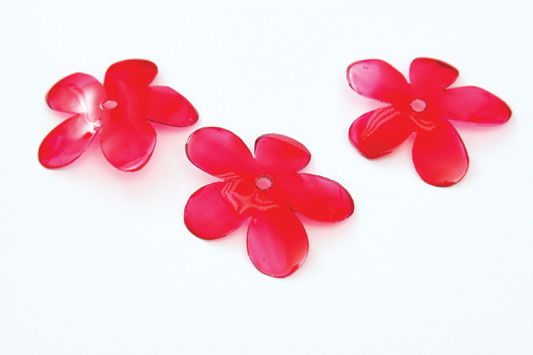 red flowers made of plastic bottle painted