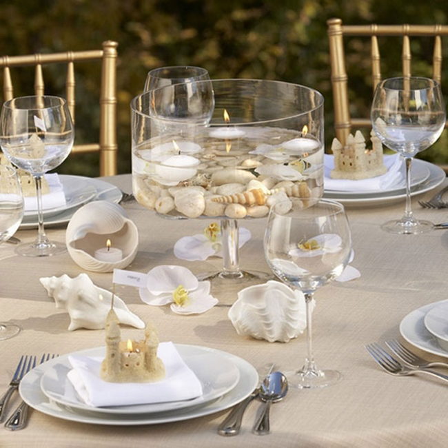 table-setting-beach-themed-party-sea-shells-floating-candles-white-orchids