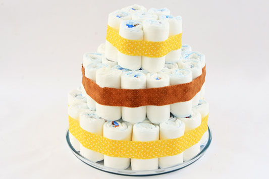 baby shower gift idea diy diaper cake neutral yellow brown ribbons