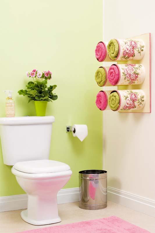 bathroom organizing ideas tin cans towel storage