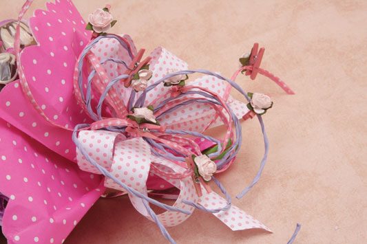 candy bouquet paper roses ribbon small clothespins
