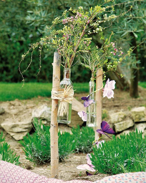 diy garden decorations glass bottles twigs butterflies