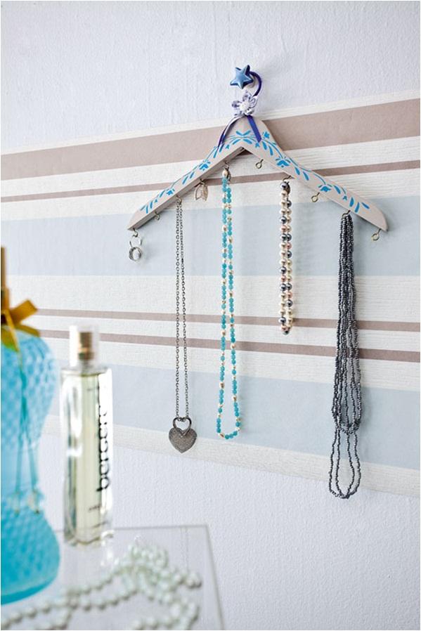diy jewelry organizer hanging necklaces clothes hanger floral stencil