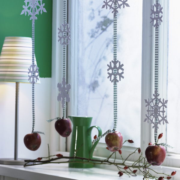 Christmas window decoration garlands apples snowflakes
