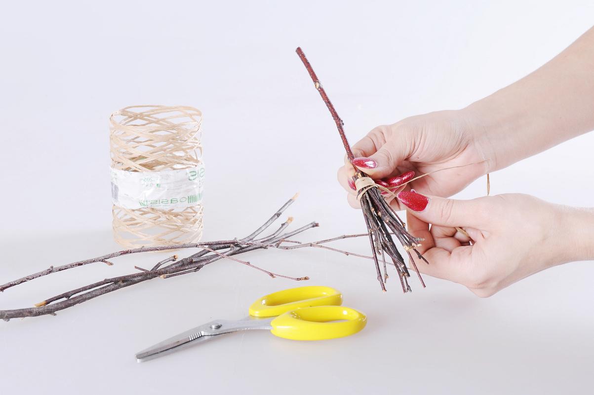 diy broom thin wood sticks raffia