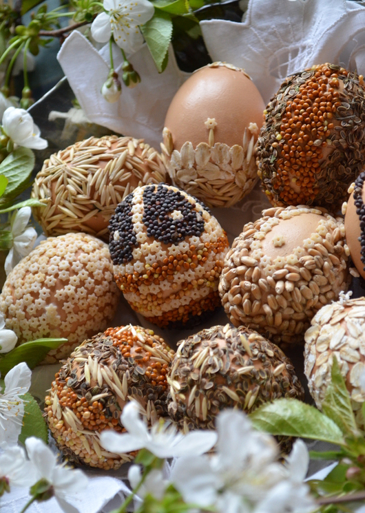 natural decorate easter eggs tiny pasta stars seeds