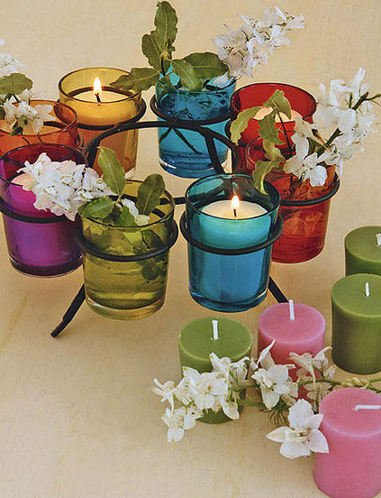 table decorating  candles colored candle holders spring blooming branches