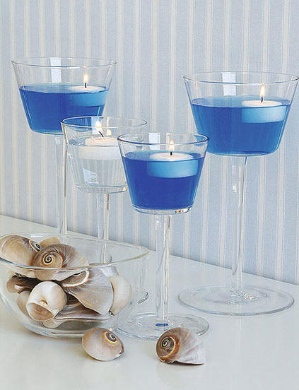 table centerpiece ideas floating candles glasses sea inspired colored water