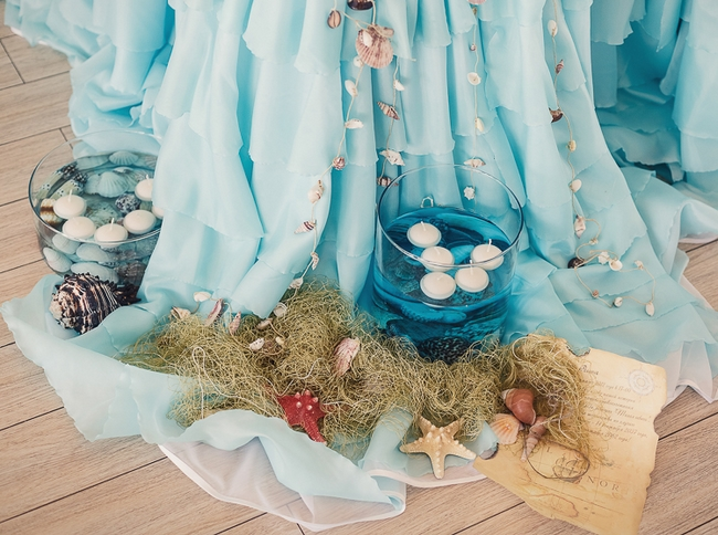 beach wedding decor ideas -reception-tablecloth-organza-floating-candles-seashells