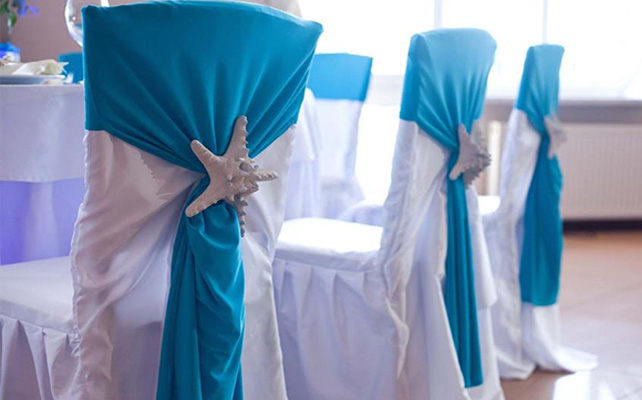 beach wedding decor ideas reception-chair-decor-white-blue-starfish-pin