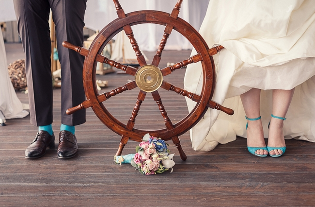 beach-themed-wedding-ideas-turquoise-bride-shoes-groom-socks-wooden-rudder