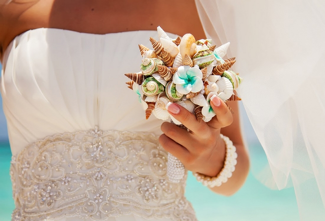 beach wedding bouquet idea seashells plumeria flowers turquoise