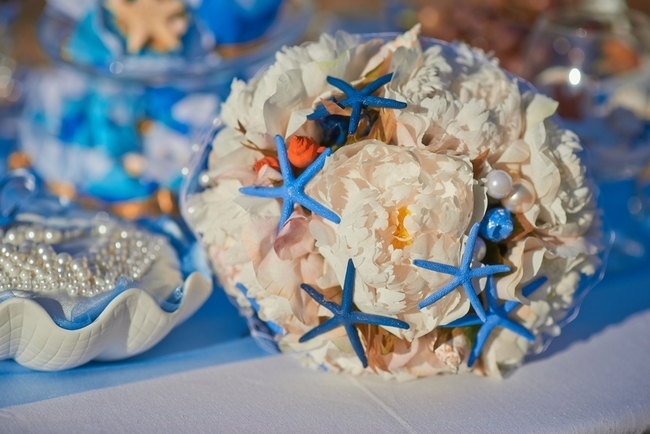 Beach wedding bouquet idea white peony roses blue starfishes