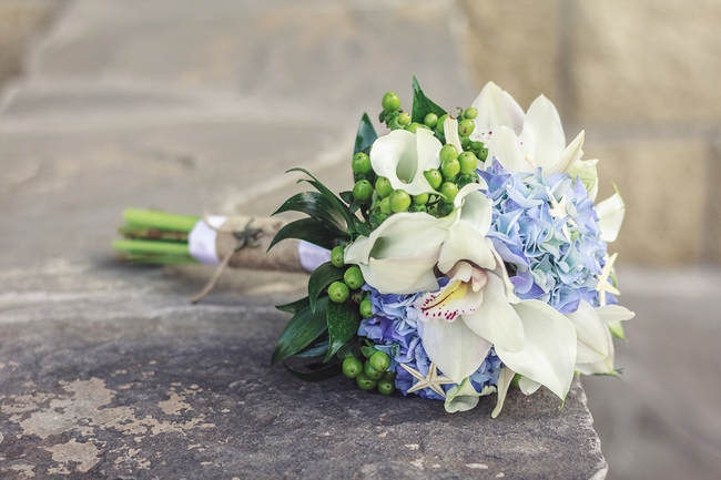 bridal bouquet white orhid blue hydrangea green berries starfishes