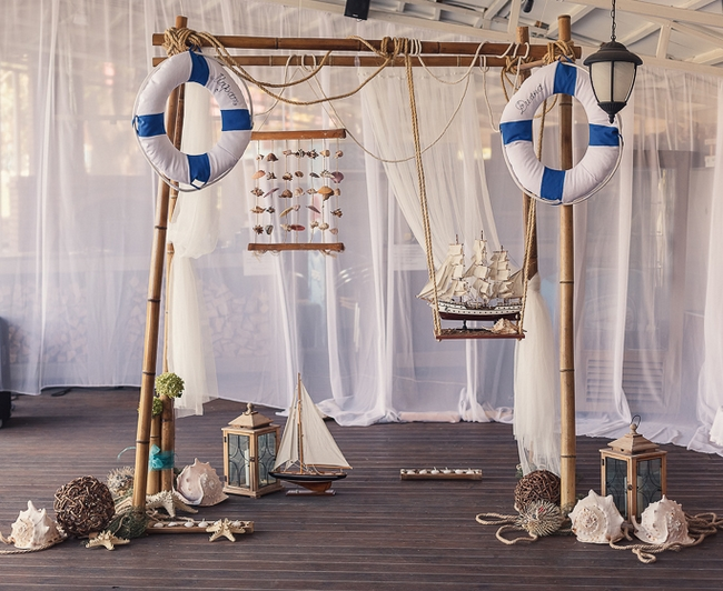 beach wedding decor ideas nautical reception-arch-lifebelts-seashells