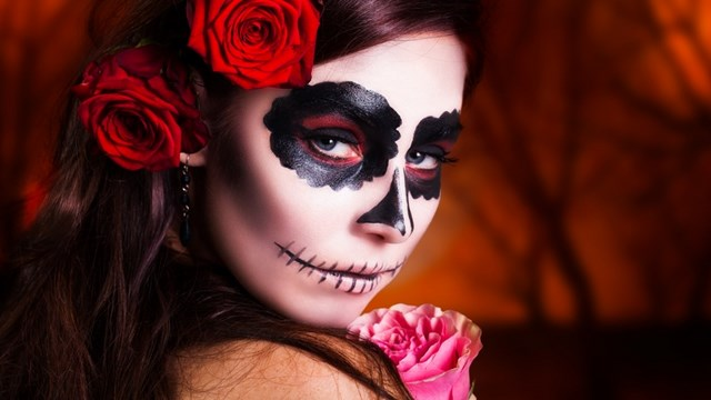feminine halloween styling sugar skull stitched mouth hair red flowers
