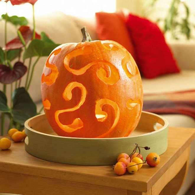 fall decorating ideas carved-pumkin-tealight-inside-tray-side-table-living-room