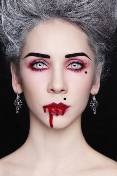 vampires have a pale face so you need white face powder apply gently ...