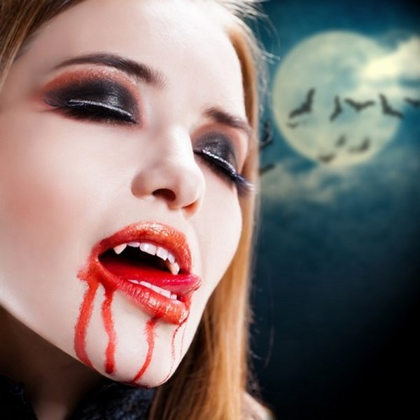female vampire scary halloween makeup ideas artificial vampire teeth fake blood