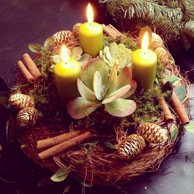 candle-centerpiece-table-wreath-pillar-candles-pinecones-succulents