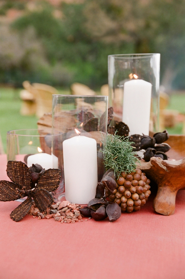 rustic-table-centerpiece-glass-hurricanes-white-pillar-candles-nuts