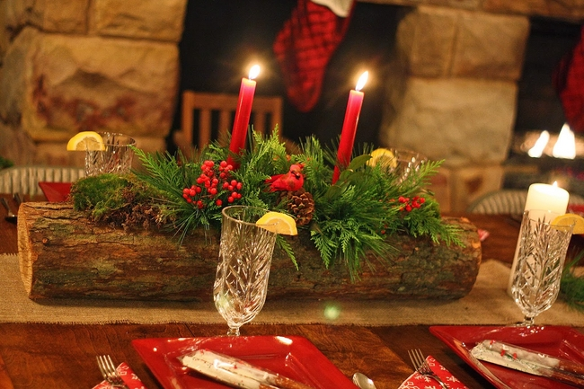 rustic-table-centerpiece-wooden-branch-evergreens-red-candles
