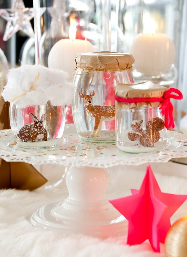 glass jars with various small animals figures christmas table decor ideas modern style pink ornaments