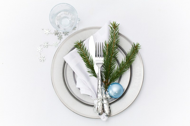 fragrand fir branches white tablecloth diy christmas table settings