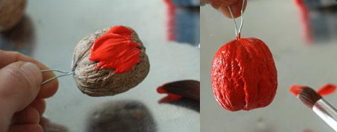 diy christmas decoration red painted nuts apple motive ornament