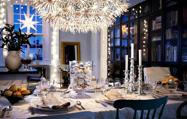 christmas table setting silver candlesticks large glass bowl light ornaments scandinavian christmas decorations white tablecloth