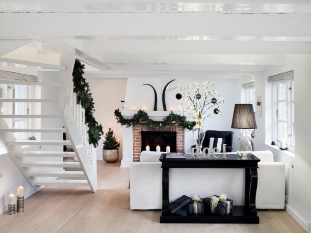 black white contrasting furniture twigs wrapped in christmas lights scandinavian christmas decorations