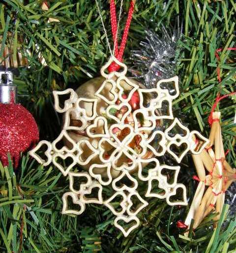 homemade-christmas-ornaments-pasta-hearts-snowflake-red-ribbon