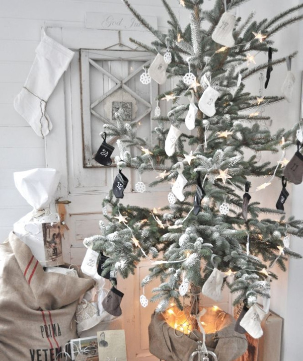 snowy tree scandinavian christmas decorations full sack of gifts numbered white baby socks tree ornaments