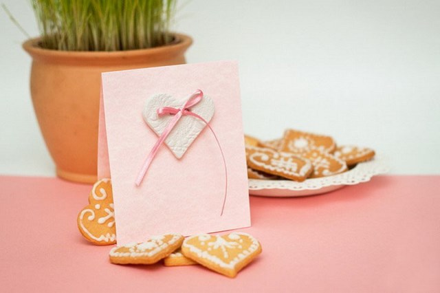 diy handmade greeting card with thin pink ribbon decoration heart shaped cookies