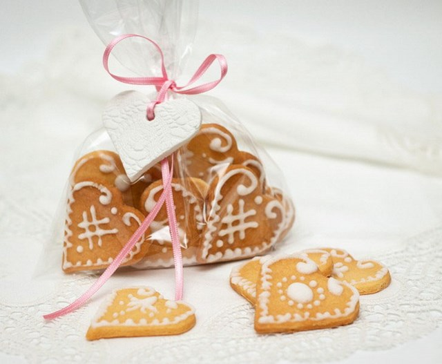 baked heart shaped cookies in cellophane bag with pink ribbon decoration