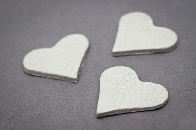 cutting out polymer clay heart shapes lace decoration