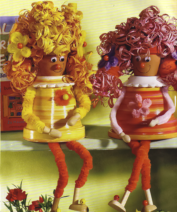 Clay Pot Women With Curly Hair Painted In Yellow And Orange