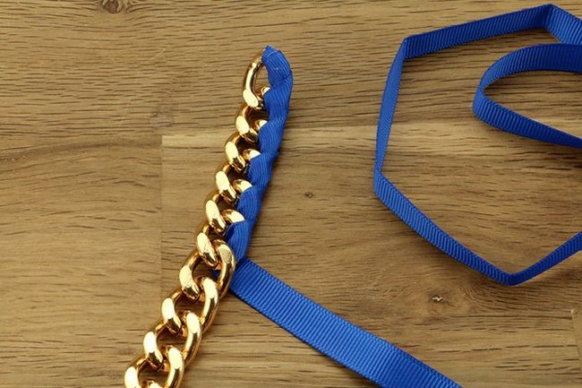 DIY chain ribbon necklace tutorial-wrapping-blue-ribbon-around-gold-chain