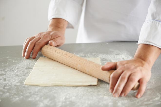 roll out puff pastry with rolling pin diy christmas decor