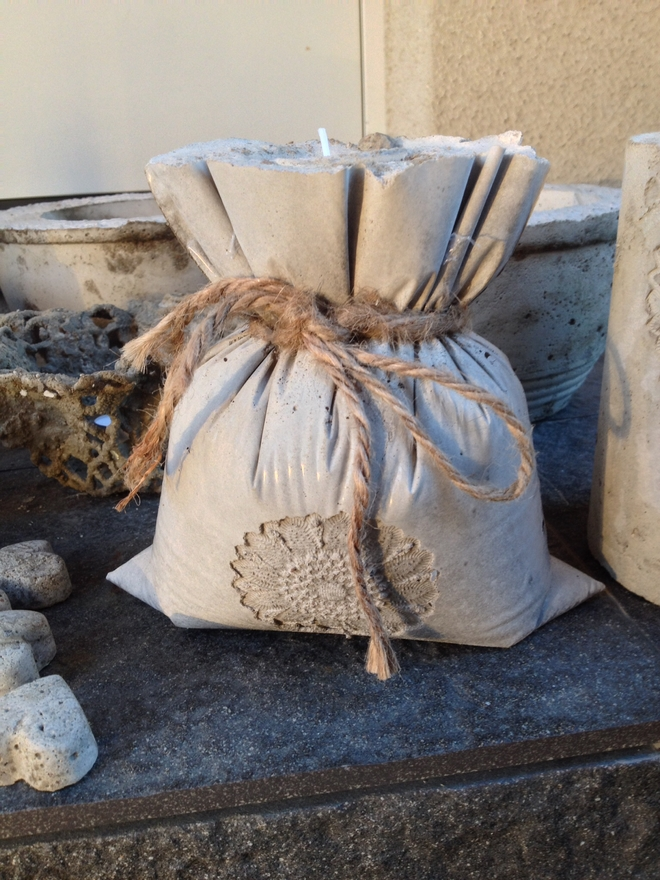 diy-garden-projects-concrete-pouch-bag-sisal-ribbon