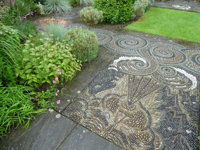 earthy-grayish-colors-pebble-mosaic-garden-decoration-cobblestones-wind-storm-motif