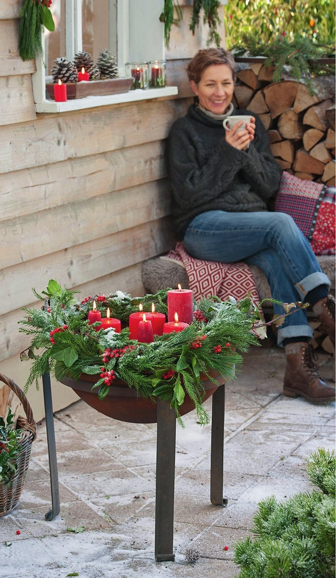 rustic outdoor christmas decor fiery bowl barbecue candle holder between pine branches