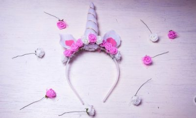 white unicorn headband with ears and pink roses