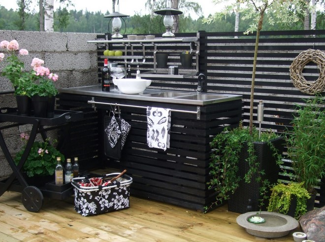 diy outdoor kitchen on deck black painted wooden slabs