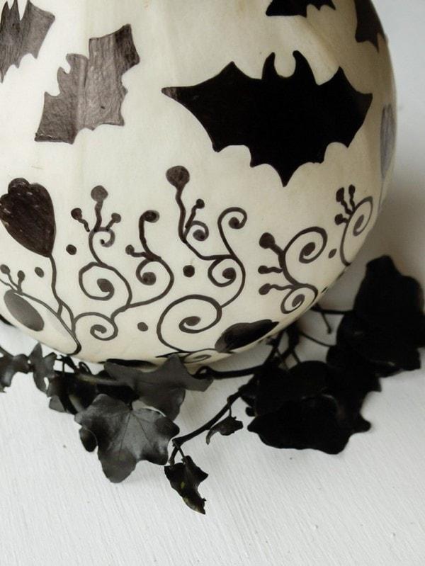 bats and black ivy twigs pumpkin surface decoration last minute halloween decorating ideas