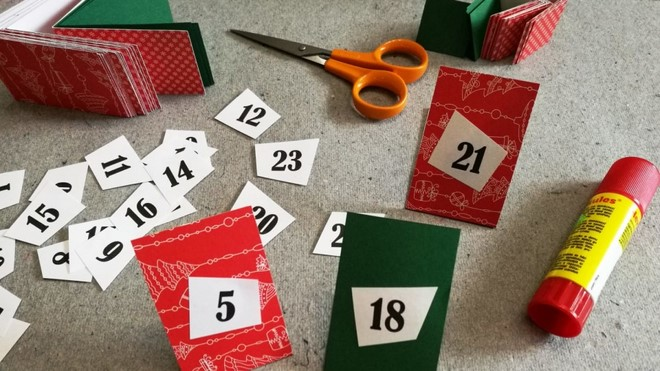 homemade advent calendar christmas themed paper and numbers