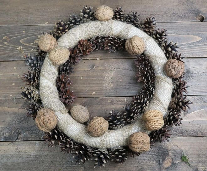 covering styrofoam wreath walnuts and cones decoration